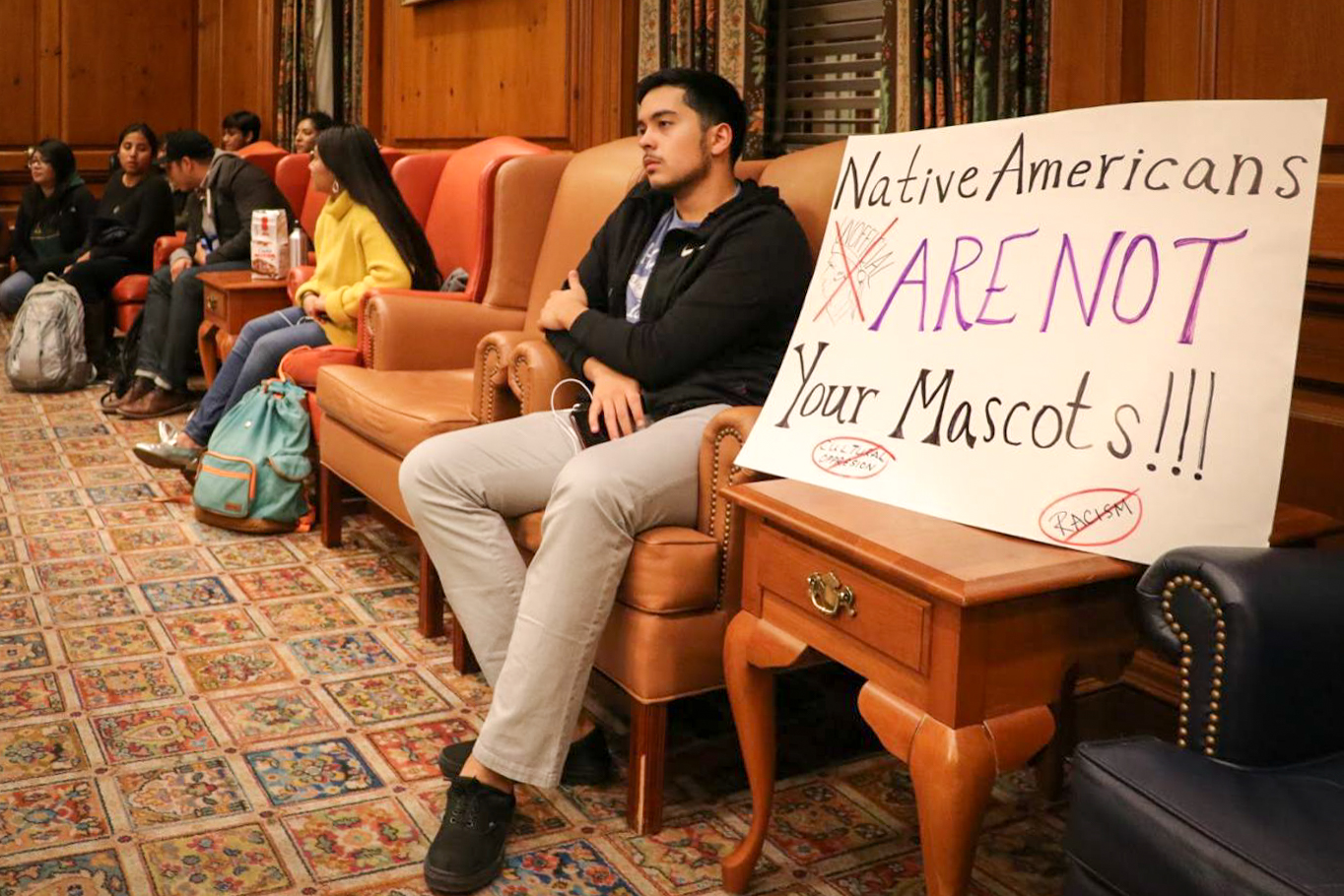A student sits in on the Illinois Student Government meeting in the Illini Union Pine Room on Wednesday, Oct. 25. The Chief will make an appearance in the Homecoming Parade, so Illinois Student Government is boycotting the parade in support of Native American students.
