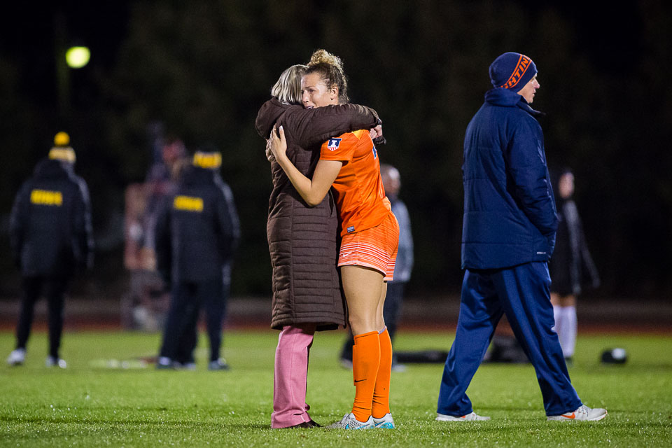 Illinois senior Kara Marbury (20) and head coach Janet Rayfield embrace after the team's final home game of the season against Iowa on Wednesday, Oct. 25. The Illini lost 1-0.
