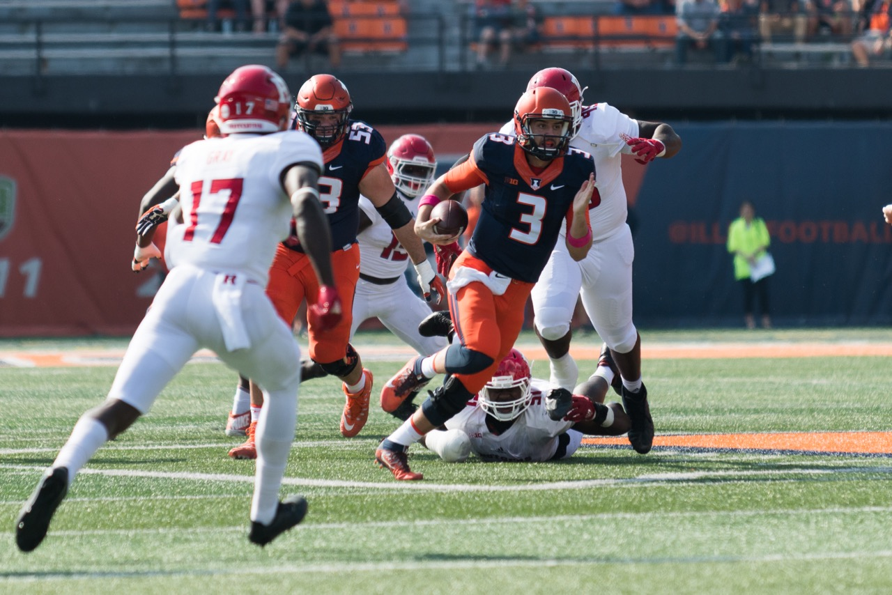 Illinois quarterback Jeff George, Jr. weaves through defenders during the game against Rutgers on Saturday, Oct. 24.  The Illini lost 35-24