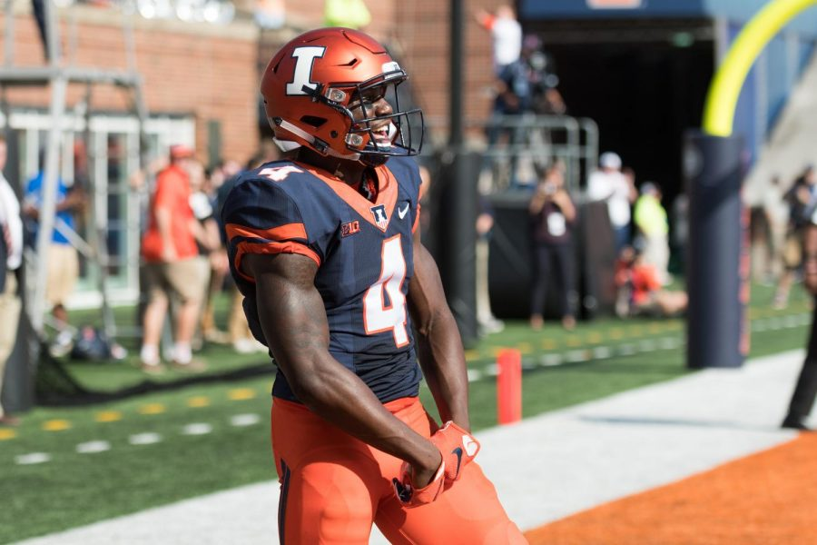 Illini+freshman+wide+receiver+Ricky+Smalling+celebrates+after+catching+a+touchdown+in+the+Illini%27s+35-24+loss+to+Rutgers.+Smalling+had+103+receiving+yards+on+the+day.