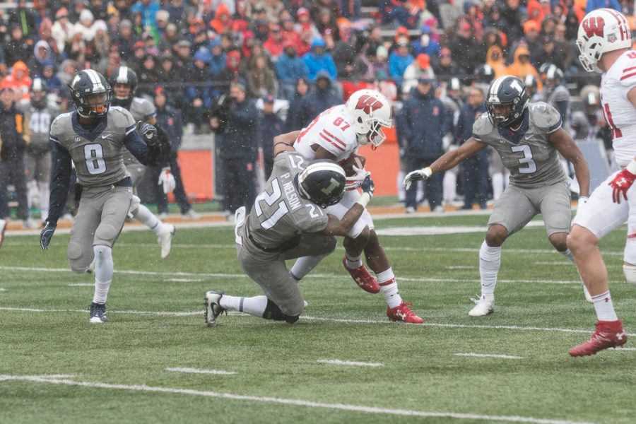 Illini safety Patrick Nelson makes a tackle during the Illini's 24-10 Homecoming loss to Wisconsin.
