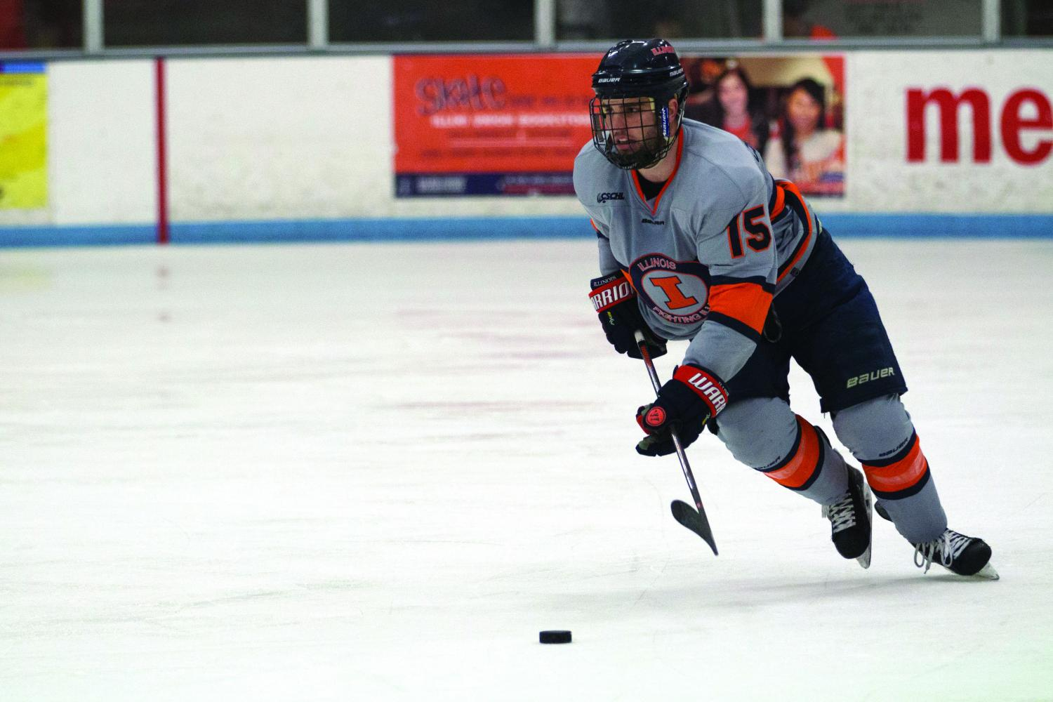 Eric Cruickshank (15) gains possession of the puck and takes it up the ice to Robert Morris' zone at the Ice Arena on Saturday, Feb. 18. Illini fell to Robert Morris 3-2.