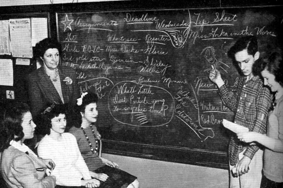 Hugh+Hefner+draws+a+cartoon+on+the+blackboard+during+his+time+as+a+student.+Hefner+graduated+in+1949.+