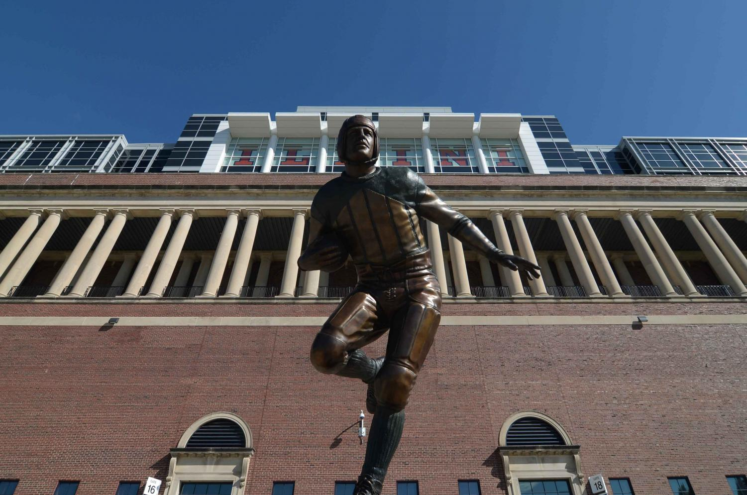 "The Harold ""Red"" Grange statue is located near the west entrance of Memorial Stadium. Grange's Homecoming Weekend game in 1924 is considered one of the best performances in the stadium to date."