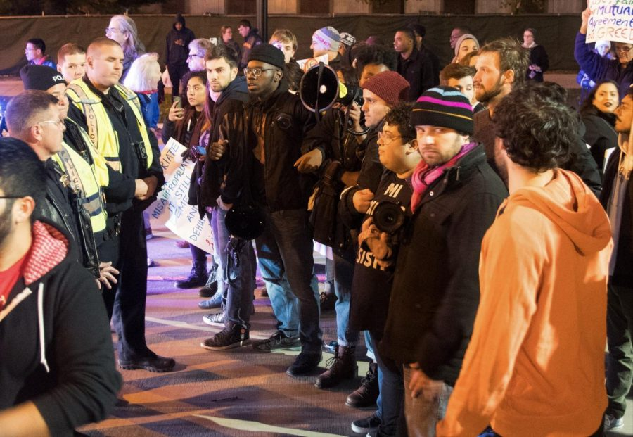 Anti-Chief Illiniwek protesters faced University police officers on the corner of Wright and Green streets after forming a blockade. The protest was organized by Illinois Student Government and included other student organizations.