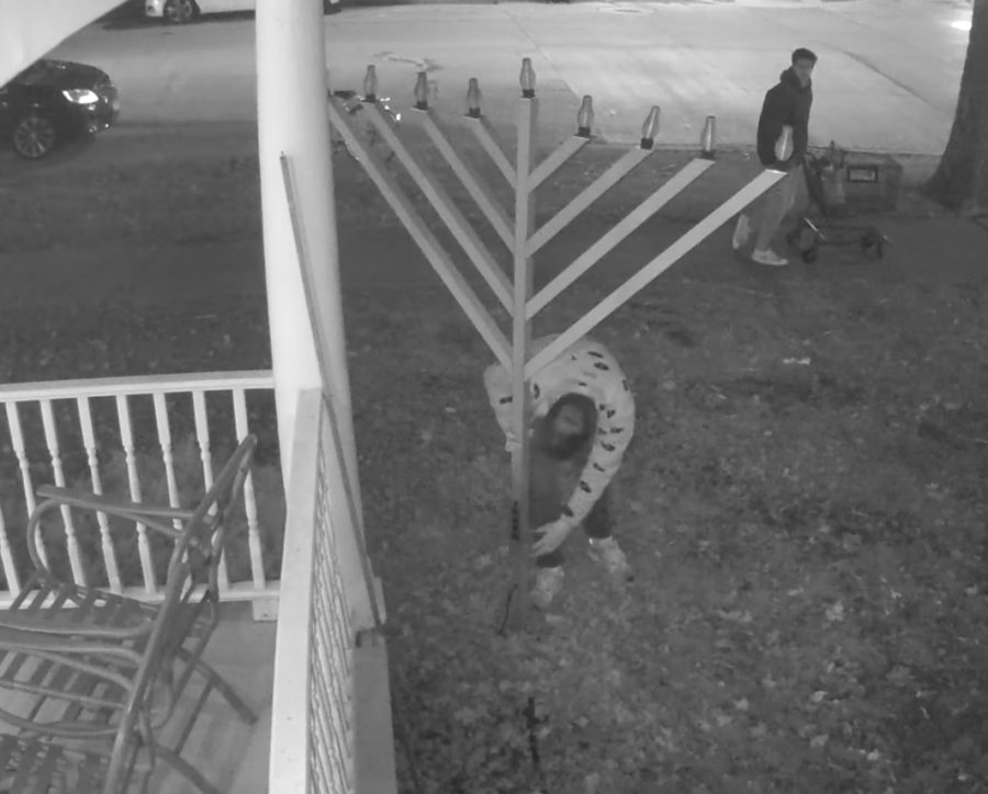Two+people+caught+on+camera+vandalized+a+menorah+in+the+front+lawn+of+the+Chabad+Jewish+Center.+The+center+is+working+on+creating+a+more+durable+structure%2C+which+should+be+completed+by+Hanukkah+of+this+year.+