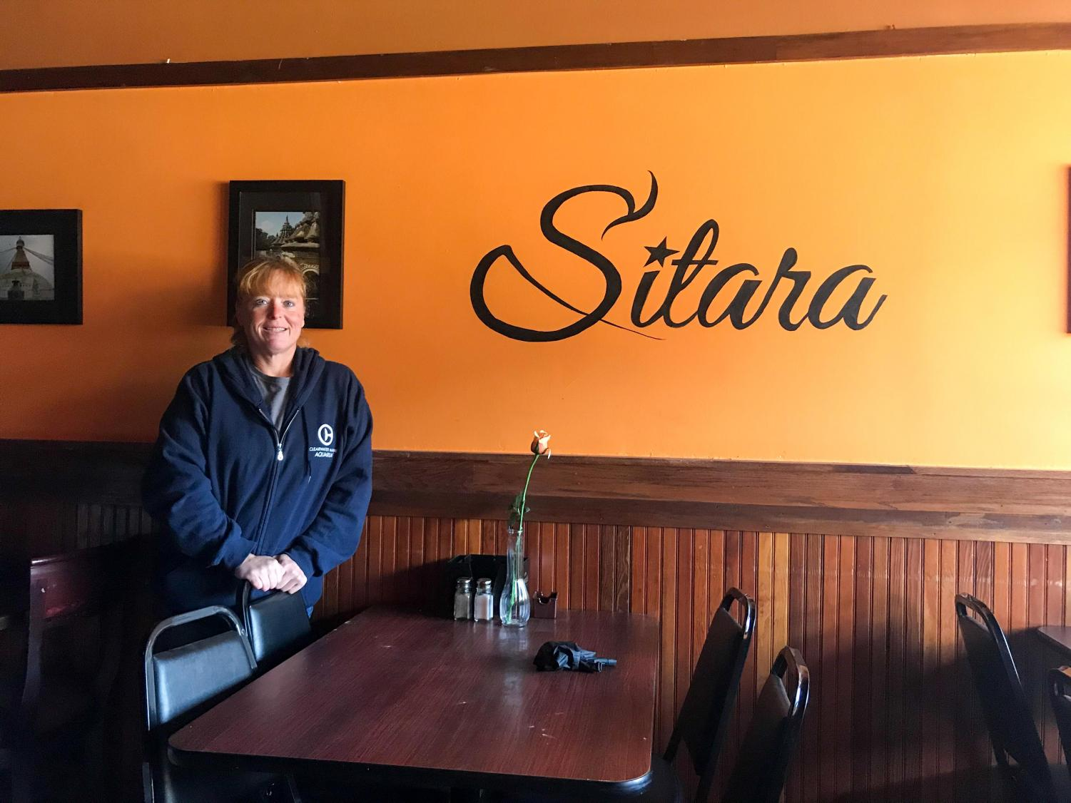 Holli Gomes, co-owner of Sitara, sits in her restaurant at 114 S Race St. in Urbana. Sitara was forced to close in October after a kitchen fire, but should reopen within the next two months.