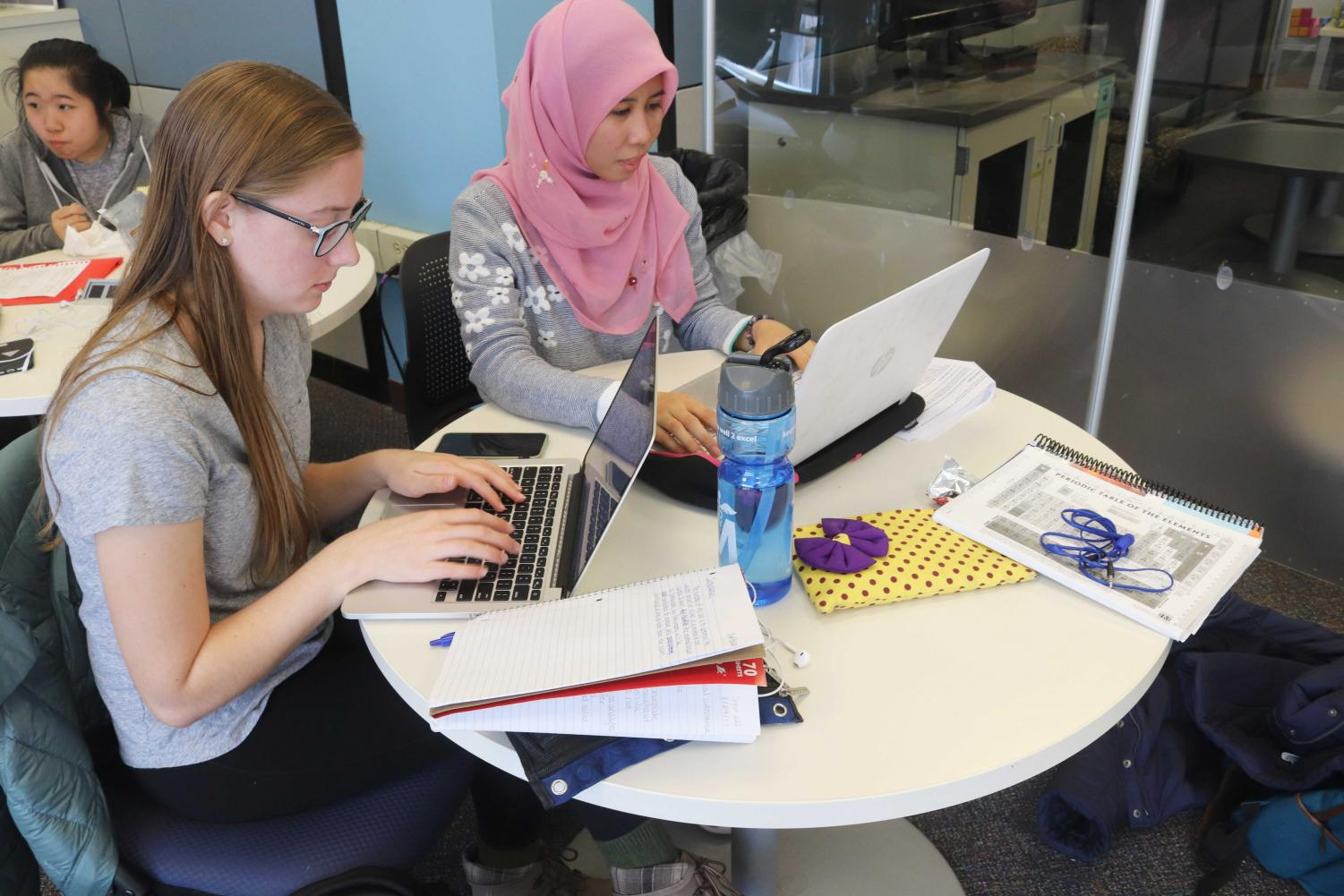 Sophomores, Eva Bucke and Hazirah Muhamad, utilize their time at the Undergraduate Library to study and work on a project together.