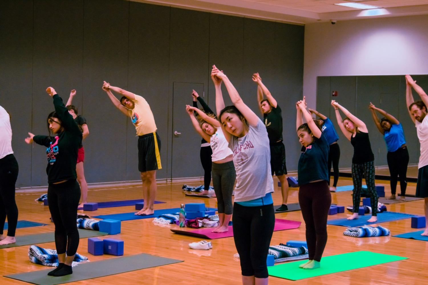 Students at the Campus Recreation Center East learn why self-care is important to their well-being and health through a two-hour yoga workshop Friday. Yoga is one of the five workshop themes in Campus Recreation Self-Care Workshop series.