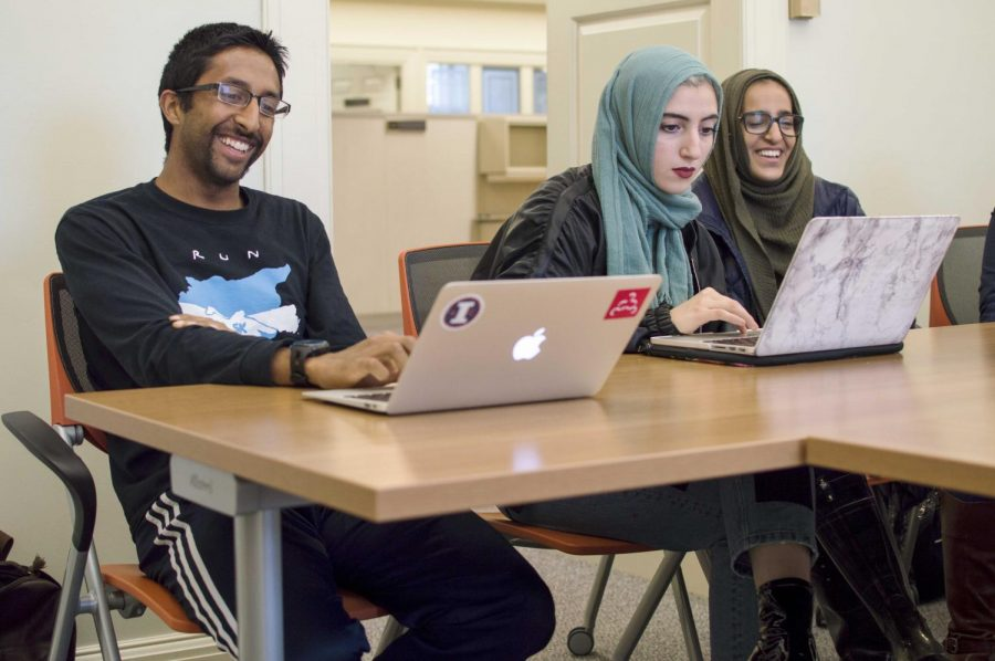 Muneeb Ansari, Noor Krad and Anushah Malik, members of the Muslim Student Association, discuss logistics for their upcoming trip to Houston to help with Hurricane Harvey relief efforts.