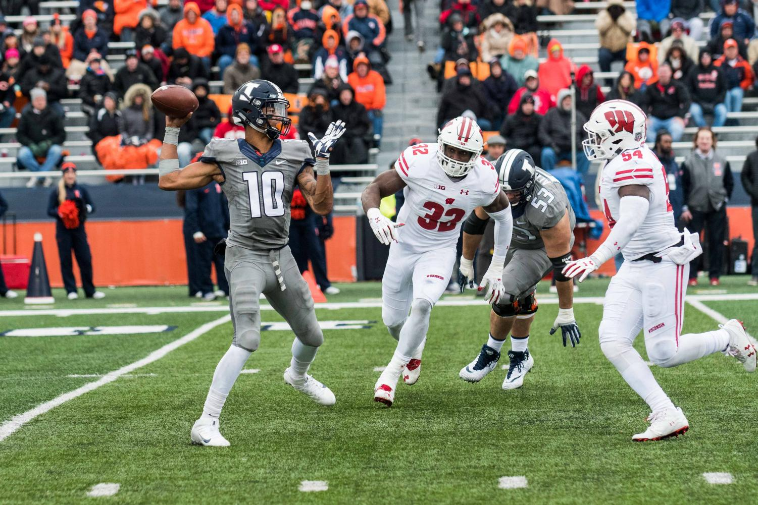 Illinois quarterback Cam Thomas throws a pass on the move during the game against Wisconsin on Oct 28. The Illini lost 24-10.