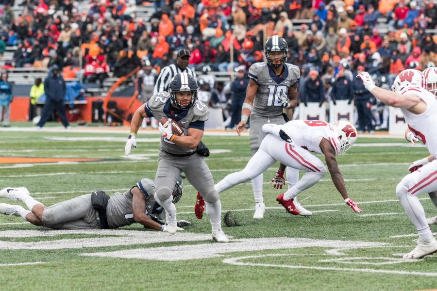 Safety Patrick Nelson makes a tackle during the Wisconsin game on Oct. 28. Nelson is one Illini transferring next season.