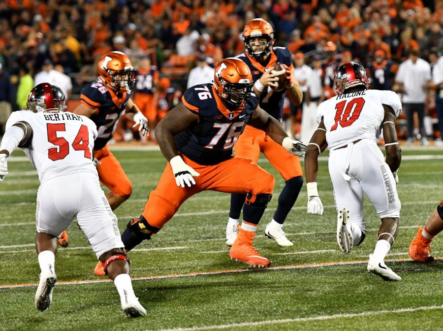 Illinois+offensive+lineman+Larry+Boyd+protects+quarterback+Chayce+Crouch+during+a+24-21+in+against+Ball+State+at+Memorial+Stadium+on+Sept.+2.+Boyd+has+seen+significant+playing+time+despite+being+a+freshman.+