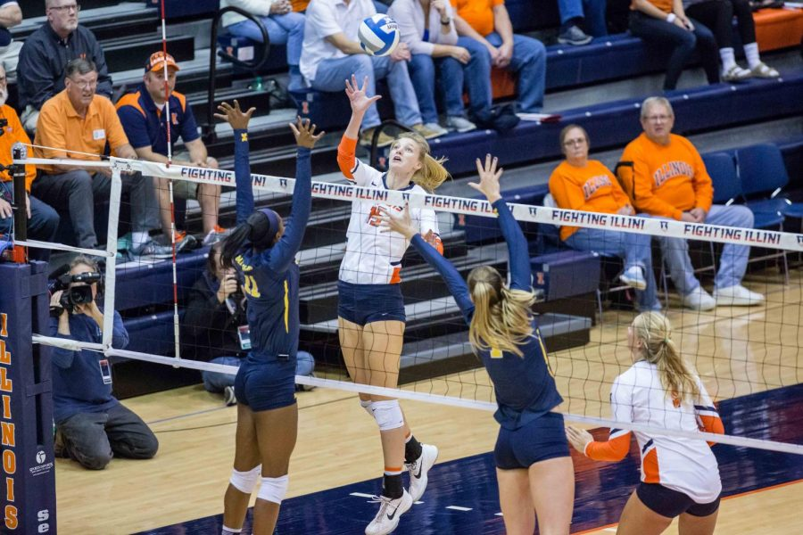 Illinois+outside+hitter+Megan+Cooney+tips+the+ball+over+the+net+during+the+match+against+Michigan+at+Huff+Hall+on+Nov.+5.+The+Illini+won+3-2.