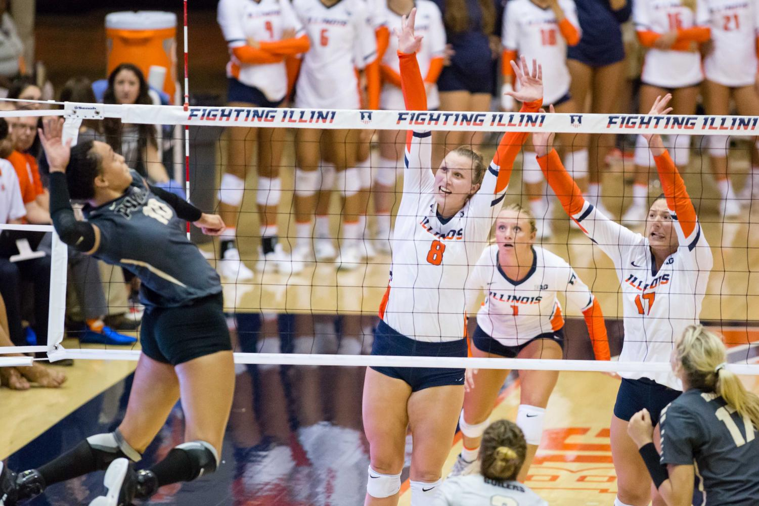 Illinois outside hitter Beth Prince (8) and Illinois middle blocker Blayke Hranicka (17) rise up the block the ball during the match against Purdue at Huff Hall on Friday, October 6. The Illini lost 3-0.