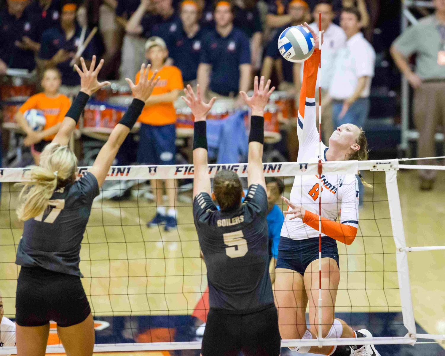 Illinois outside hitter Beth Prince (8) hits the ball during the match against Purdue at Huff Hall on Friday, October 6. The Illini lost 3-0.