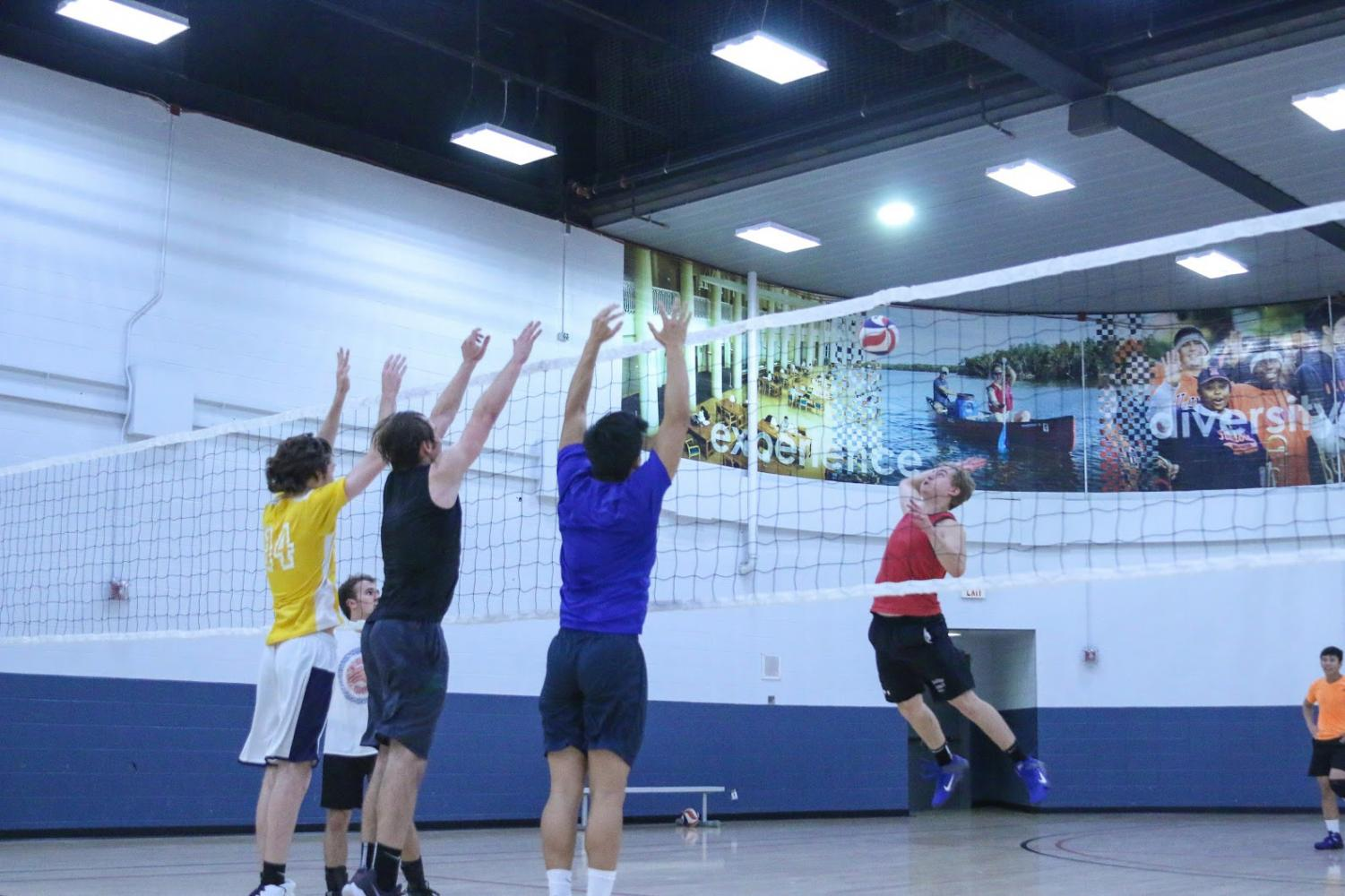 Kyle Biedron, Junior, spikes the ball during an Illini men's club volleyball practice at the ARC on Thursday November 2, 2017.