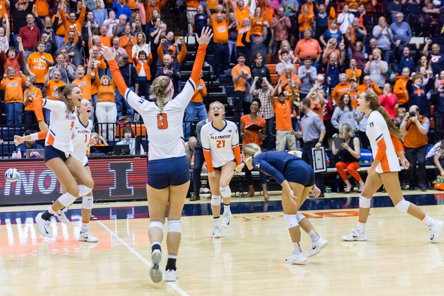The Illini celebrate after scoring a point during the match against Michigan at Huff Hall on Saturday, Nov. 5, 2017. The Illini won 3-2.