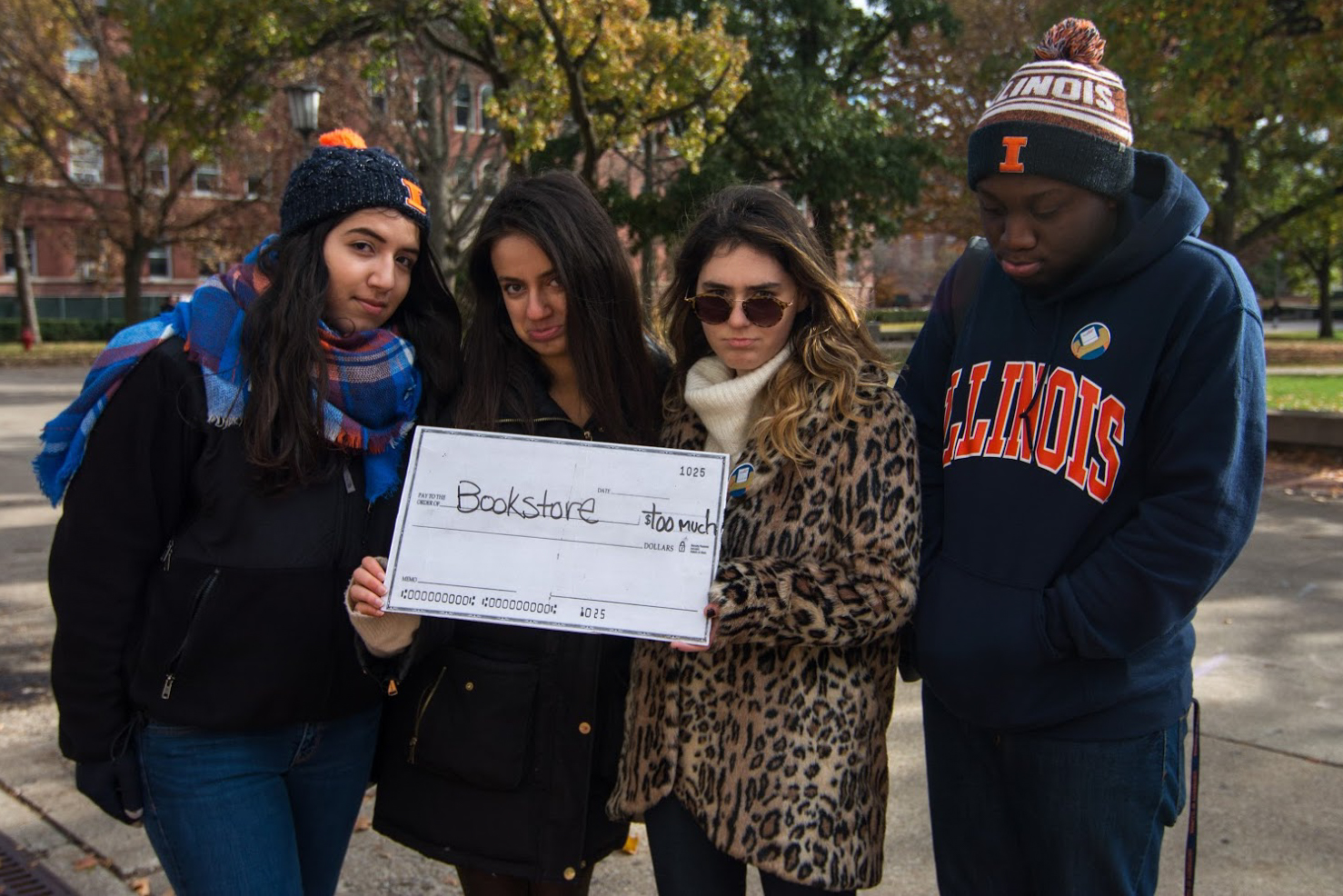 Students from the Illinois Student Government hold a booth to support open-sourced textbooks for University of Illinois students in front of the Illini Union on the Main Quadrangle.