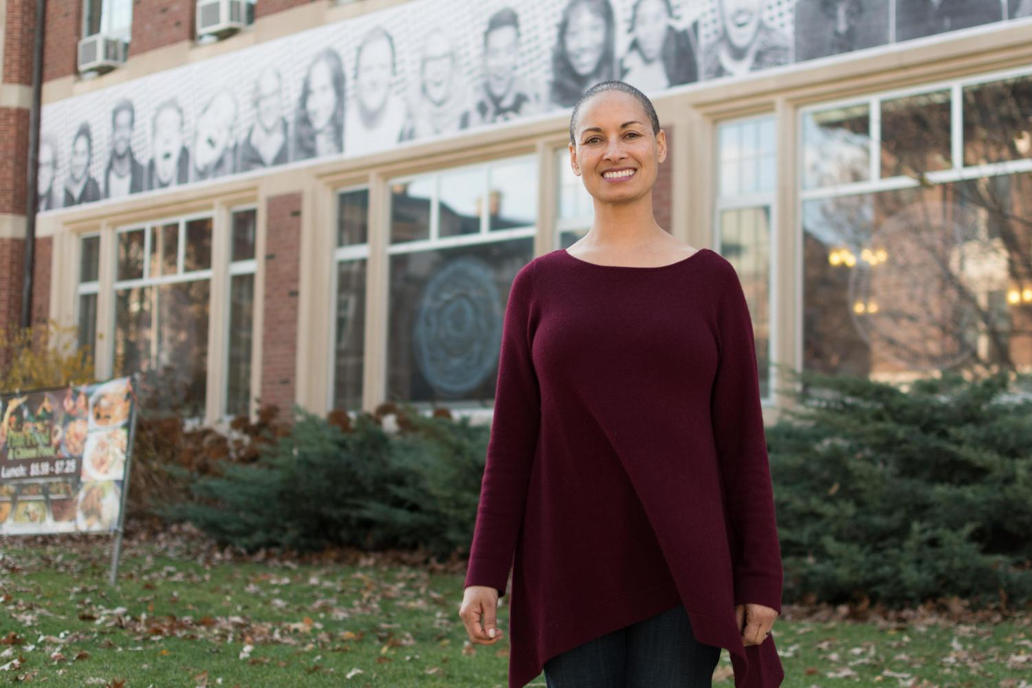 Rebecca Ginsburg works with the Education Justice Project located at the YMCA. Here, she poses in front of the University YMCA.