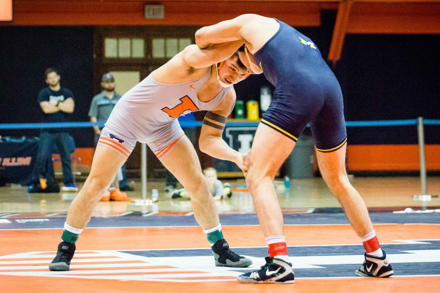 Illinois' Isaiah Martinez wrestles with Michigan's Logan Massa in the 165 pound weight class during the match at Huff Hall on Friday, Jan. 20. Martinez won by decision and the Illini defeated the Wolverines 34-6.