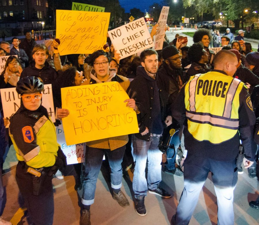 Anti-Cheif Illinwek protestors faced police officers on the corner of Wright and Green streets. The protest was organized by the Illinois Student Government and included other student organizations.