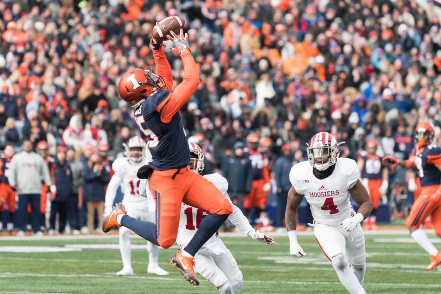 Illinois wide receiver Trenard Davis leaps for a catch during the game against Indiana on Saturday, Nov 11. The Illni trail 0-14 at half.