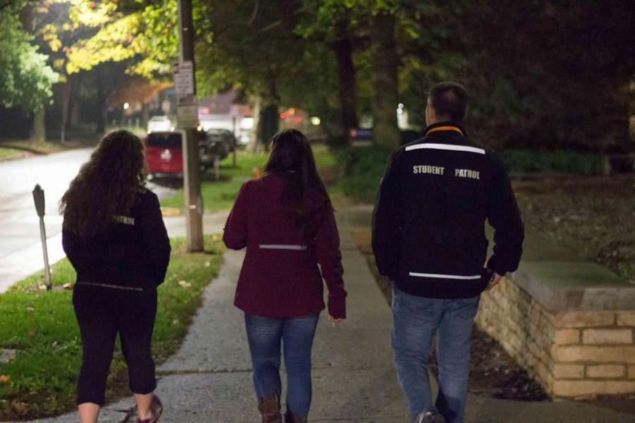 Student Alyssa Pappas walks east on Springfield Avenue with Student Patrol officers Hannah McCullough and Zach Armstrong on Nov. 4. SafeWalks is a service mentioned by assistant Features editor Marissa to take advantage of while on campus.
