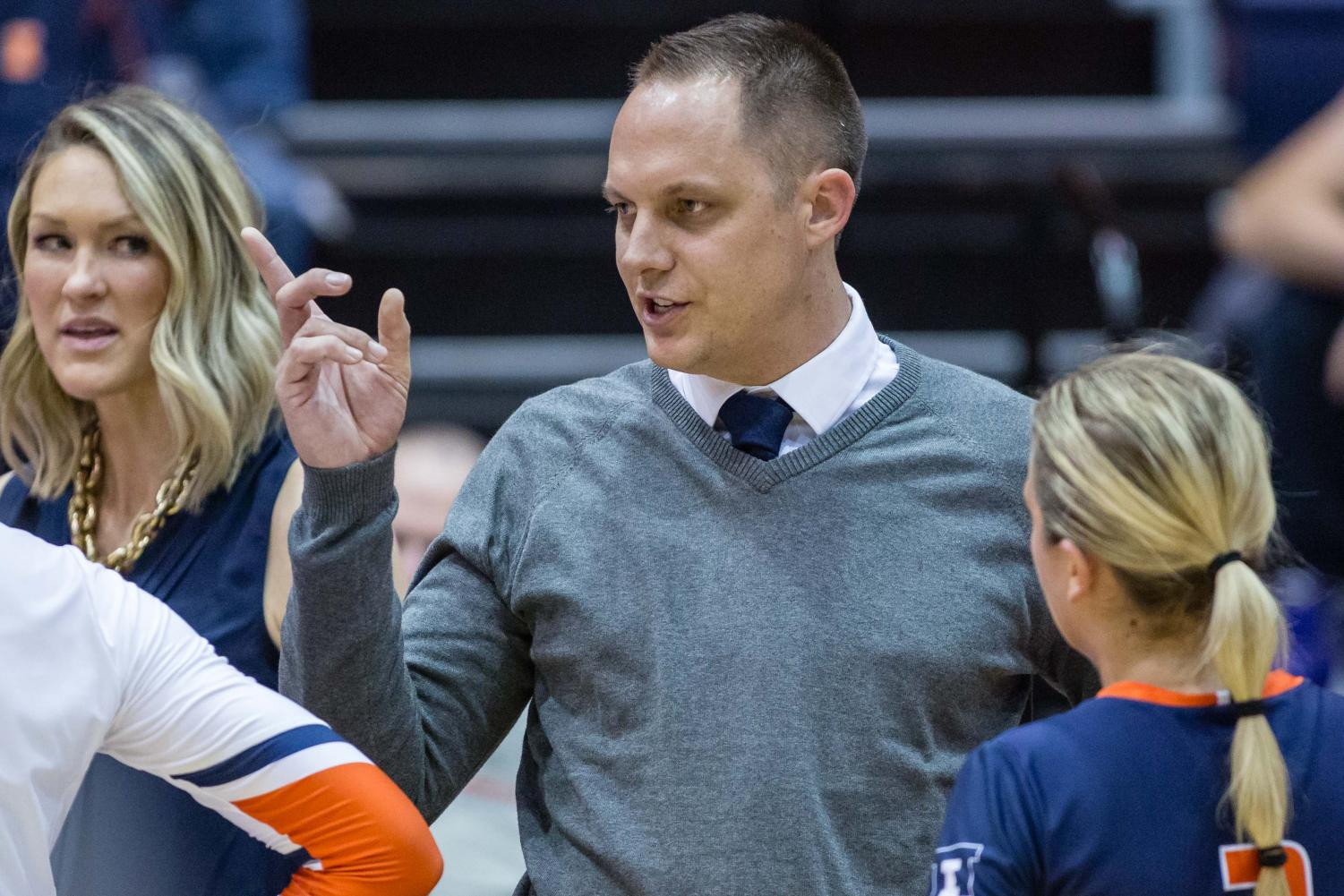 Illinois head coach Chris Tamas talks to his team during a timeout in the match against Michigan at Huff Hall on Saturday, Nov. 5, 2017. The Illini won 3-2.
