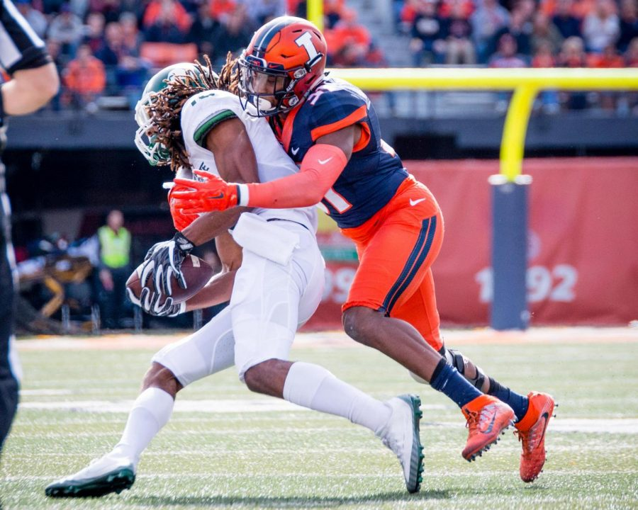 Illinois+linebacker+Tr%C3%A9+Watson+%2833%29+makes+a+tackle+during+the+game+against+Michigan+State+at+Memorial+Stadium+on+Saturday%2C+November+5.+The+Illini+won+31-27.