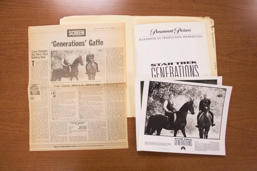Photograph of newspaper clippings and photographs from film sets in Roger Ebert's archive.