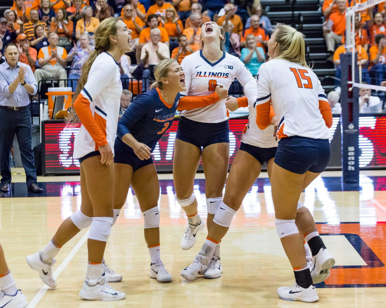 Illinois defensive specialist Brandi Donnelly (3) and her team celebrate during the match against Stanford at Huff Hall on Friday, September 8. The Illini lost 3-0.