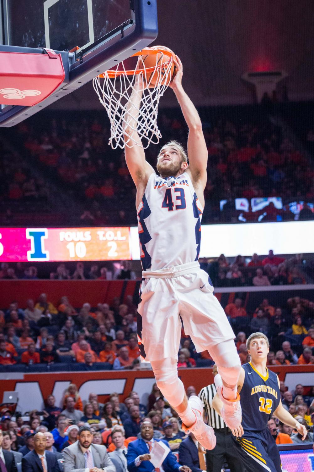 Illinois forward Michael Finke jumps for a slam dunk during the game against Augustana at the State Farm Center on Nov. 22.