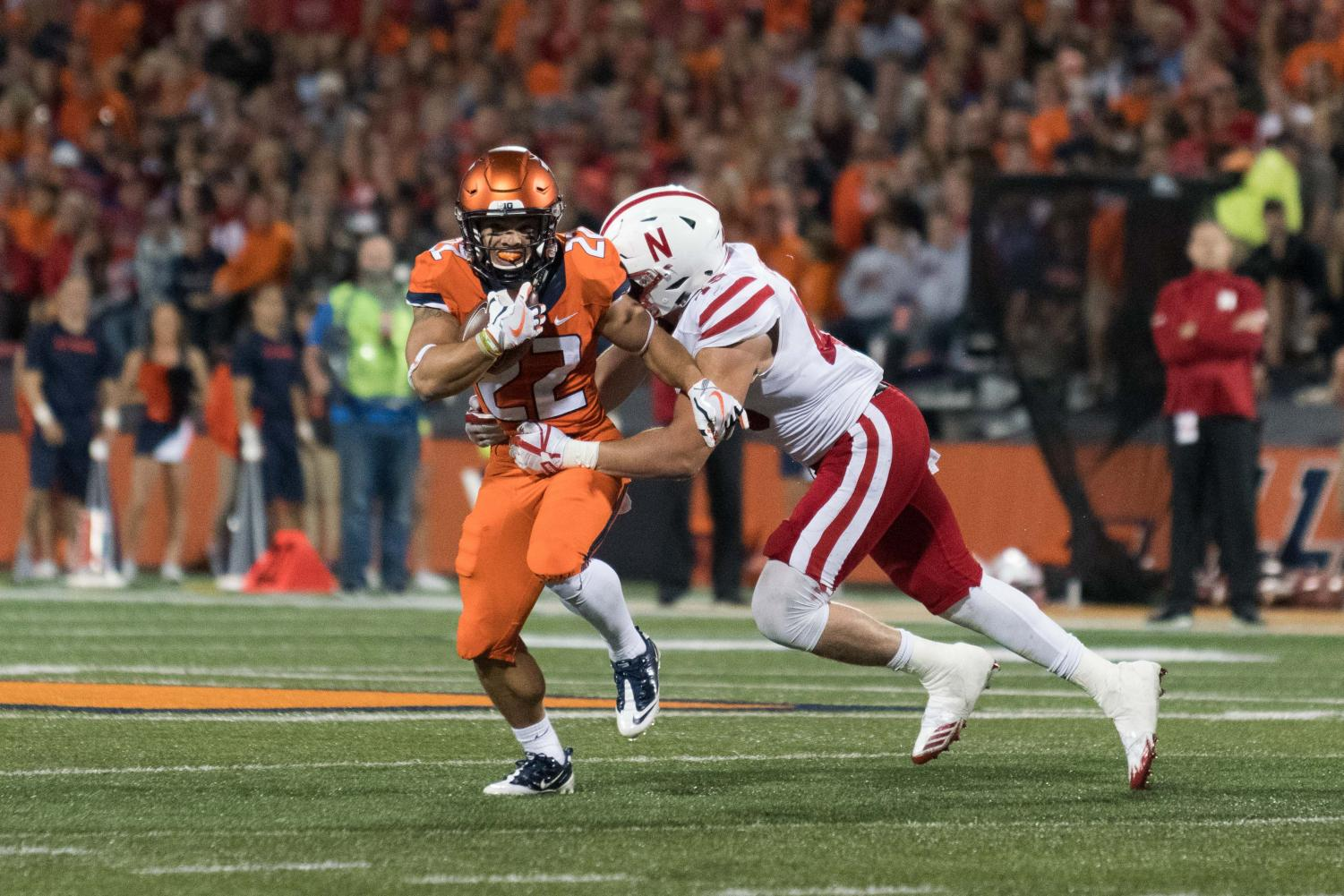 Illinois running back Kendrick Foster is tackled during the game against Nebraska at Memorial Stadium.  The Illini fell 28-6.