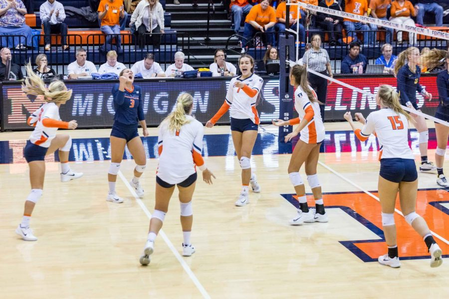 The+Illini+celebrate+after+scoring+a+point+during+the+match+against+Michigan+at+Huff+Hall+on+Saturday%2C+Nov.+5%2C+2017.+The+Illini+won+3-2.