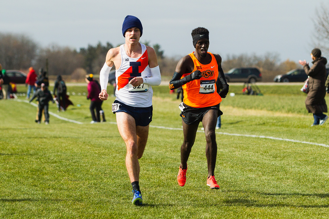 Jon Davis runs alongside an opponent from Oklahoma State. Davis was the third Illini ever to win Regionals.