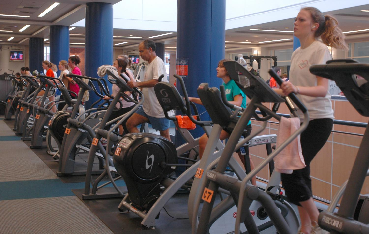 Students use the elliptical machines at CRCE. CRCE is just one of many workout options on campus.