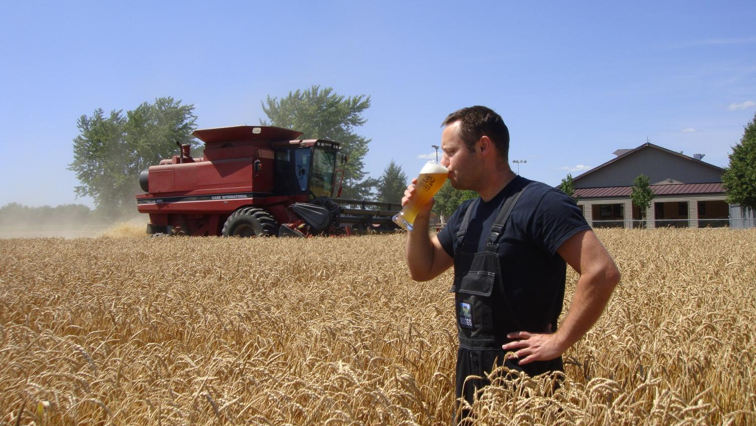 Riggs Beer Company Makes Final Steps To Become Solar Powered  The  Matt Riggs Holds An American Lager While Standing In A Field The Riggs  Beer Company