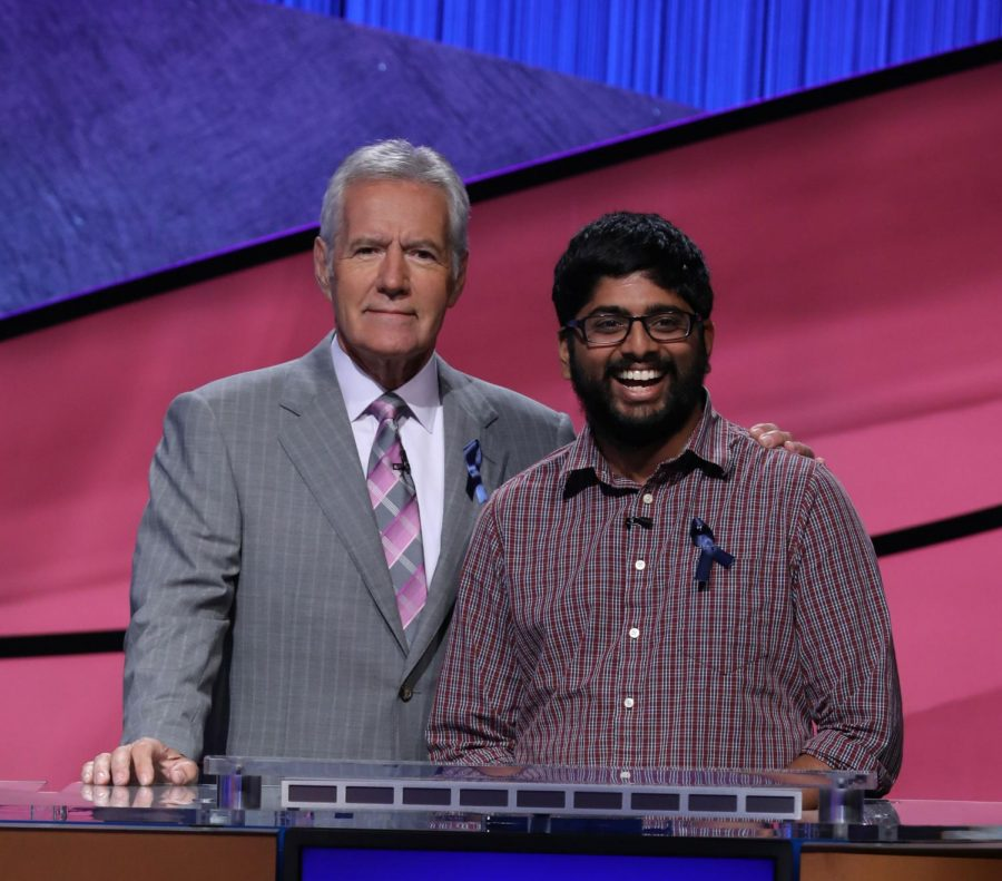 Pranjal Vachaspati, graduate student in Engineering, poses with Alex Trebek, gameshow host for Jeopardy! Vachaspati is a five-time champion on the gameshow.