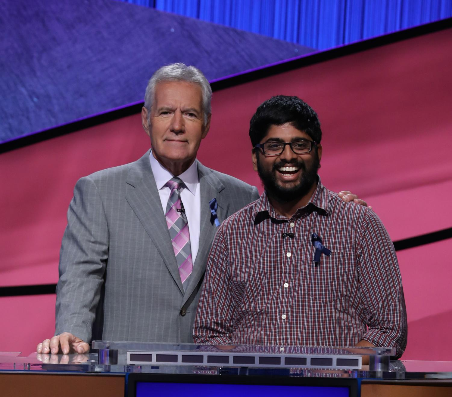 Pranjal Vachaspati, graduate student in Engineering, poses with Alex Trebek, gameshow host for