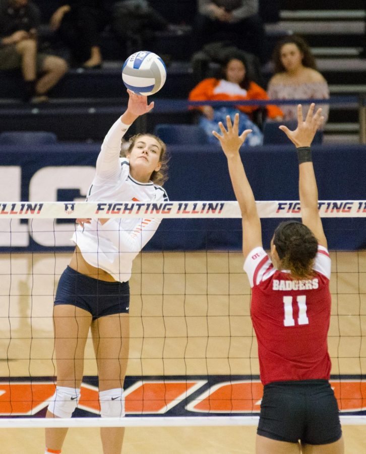 Jacqueline Quade splkes the ball to the Wisconsin side of the net during Illinois game on Friday, November 17.