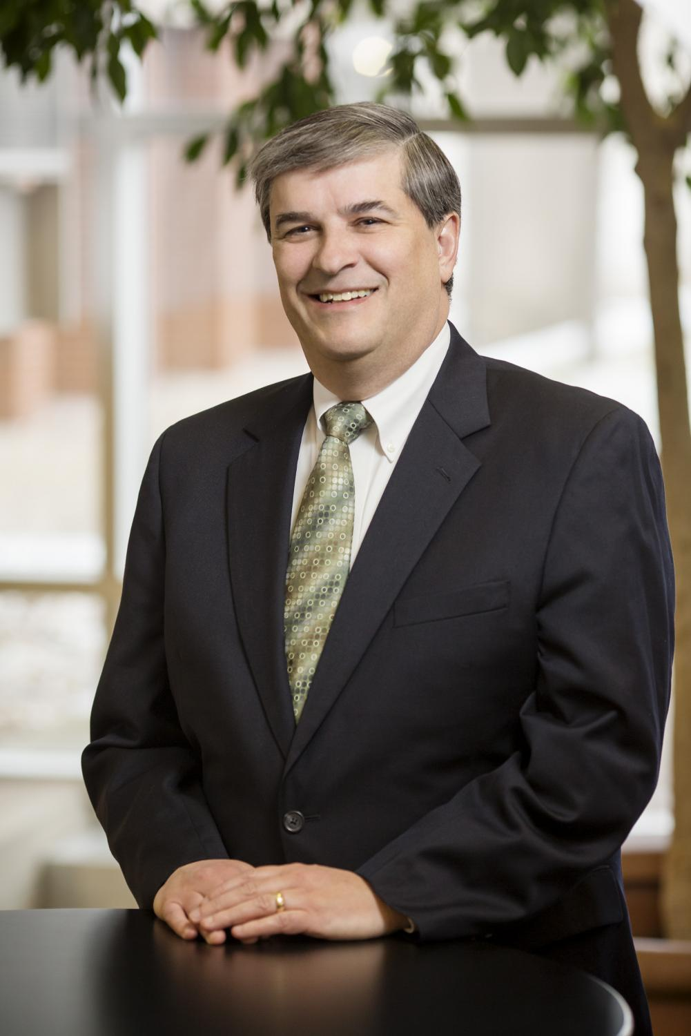 University professor Robert Lawless poses for a portrait. He, among other University faculty and a student, researched bankruptcy misconceptions among minorities.