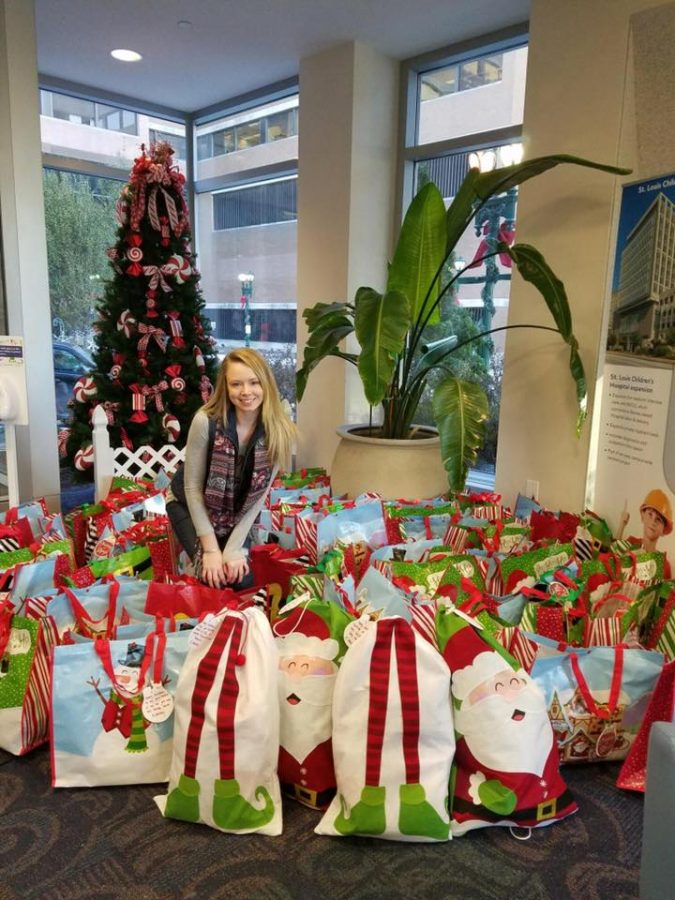 Whitney Setterdahl sits with her donations to Barnes-Jewish Hospital in St. Louis. Last year, Setterdahl raised over $3000 dollars for her charity Stockings for Strength.