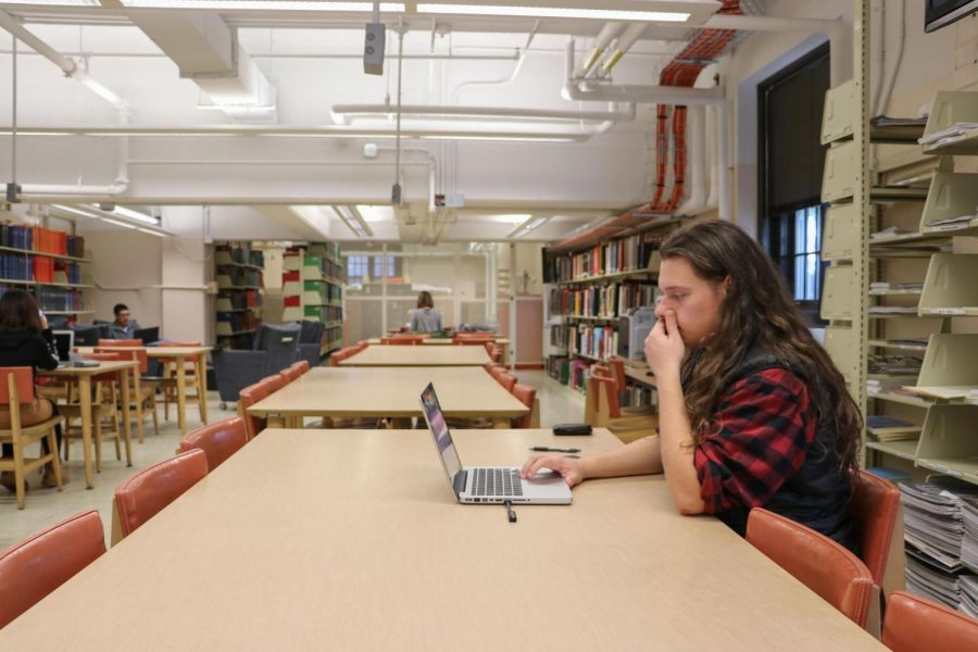 Michal Cylwik, Sophomore majoring in Communications, is studying in media basement floor of the Communications Library