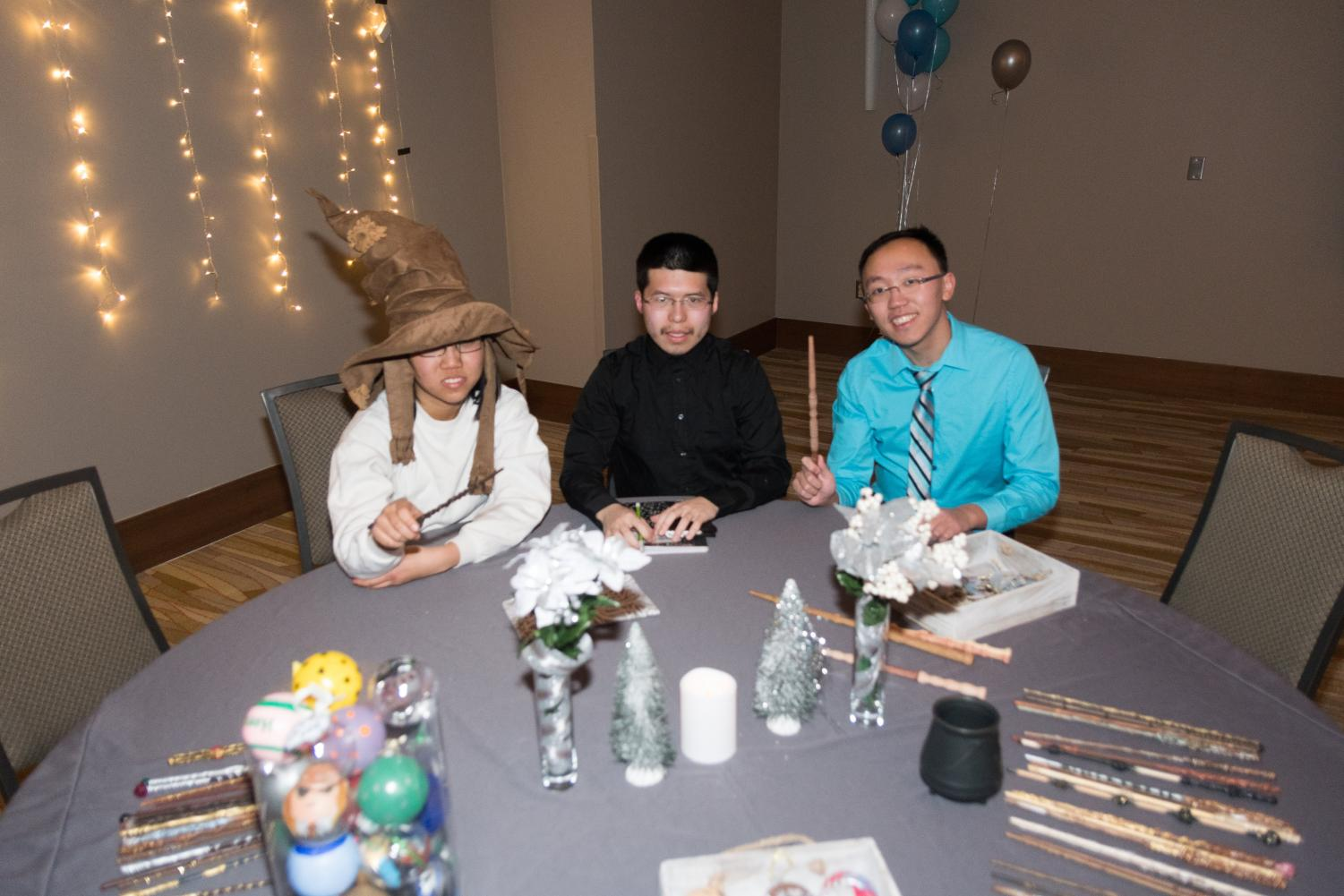 Students Hui Yi Koh, Mark Guo, and Ming Lin man the giveaways table.  The third annual Yule Ball took place at the I Hotel Conference on Friday, Jan. 19.