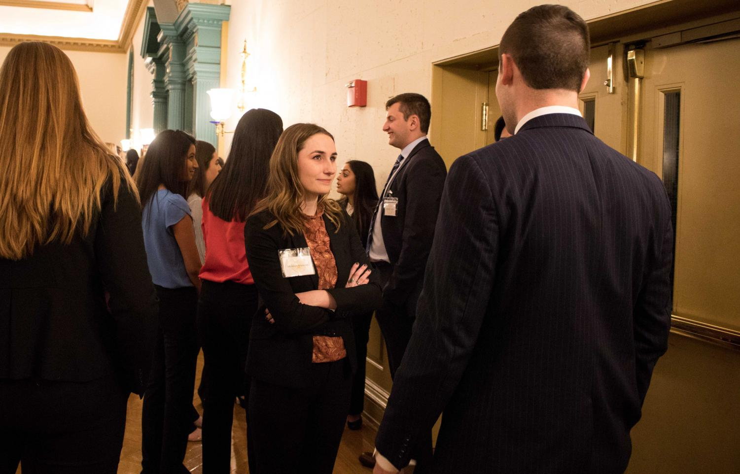 53bab74c235 Member Bridget Maguire talks to an interested student at the Alpha Kappa  Psi Business Fraternity info
