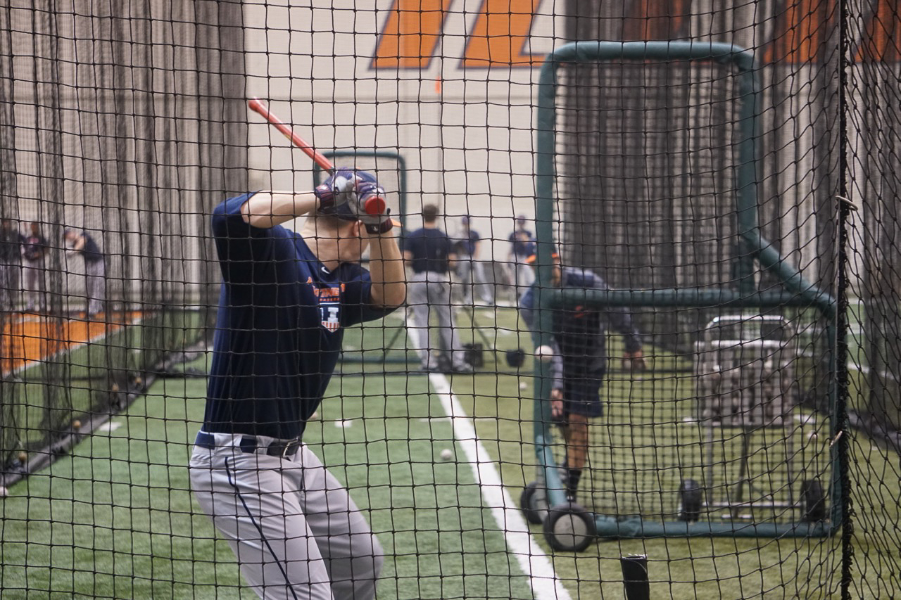 Junior outfielder Doran Turchin takes a swing during batting practice on Jan. 26. Turchin started 48 games for the Illini last season, batting .275 with eight home runs.
