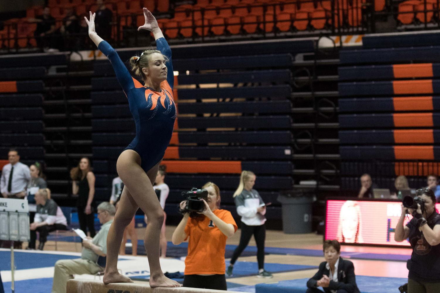Bridget Hodan competes on beam against Michigan State in Huff Hall on February 17.
