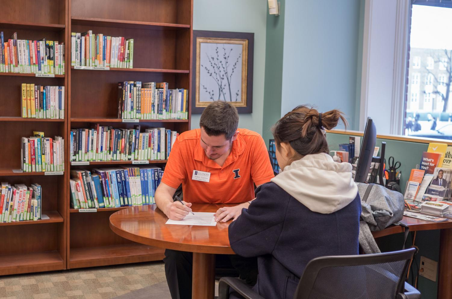 A student meets with James Castree, graduate assistant for career planning and campus outreach for the Career Center. The Career Center has several advisers that can offer guidance to picking a major or applying to graduate school.