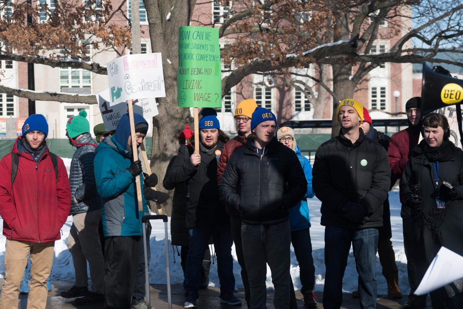 Graduate employees protest for a fair contract at the Alma Mater on Jan. 18. The Graduate Employees' Organization began bargaining with the University on March 30. Graduate employees are now over 160 days without a contract.